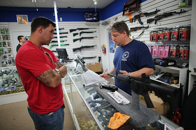 Customer looking at AR-15 in gun store