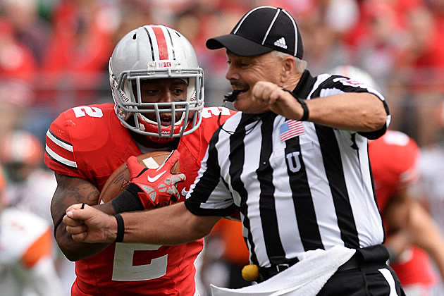 Ohio State running back plows the umpire