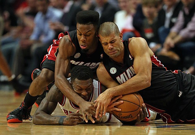 Norris Cole #30 (L) and Shane Battier #31 of the Miami Heat battle for a loose ball with Nate Robinson #2 of the Chicago Bulls in Game Four of the Eastern Conference Semifinals during the 2013 NBA Playoffs