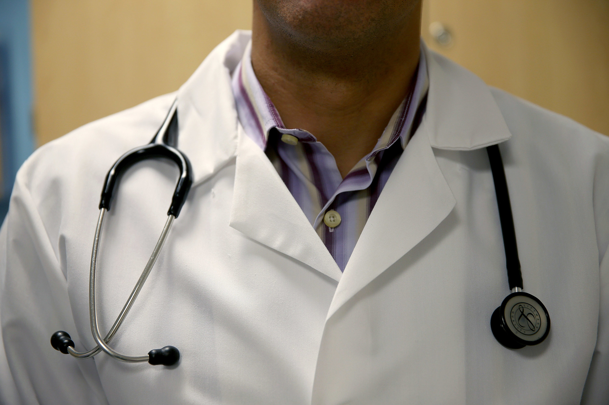 A doctor wears a stethoscope